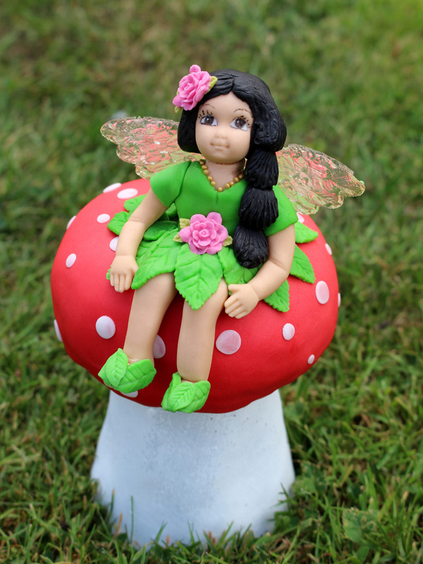 Fairy-cake-topper-with-toadstool-and-flowers