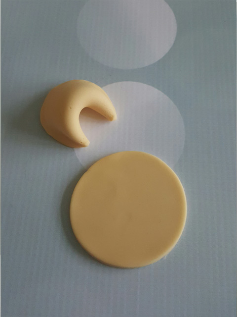 Making-fortune-cookies-out-of-fondant-for-cake-decorating-project